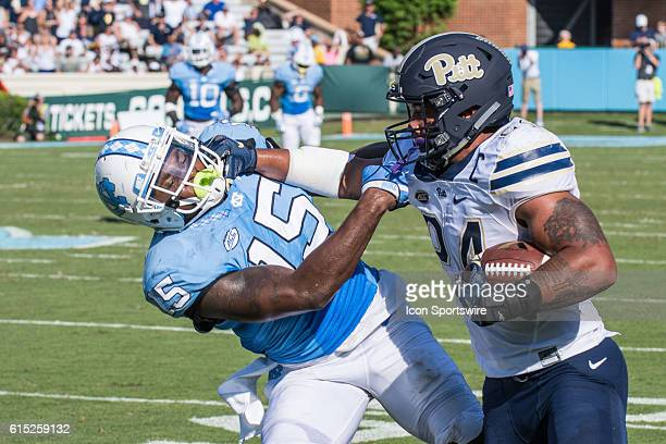 Pittsburgh Panthers running back James Conner straight arms North Carolina Tar Heels safety Donnie Miles NCAA College Football North Carolina Tar...