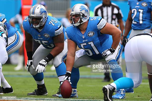 Detroit Lions center Dominic Raiola and offensive guard Larry Warford call blocking changes during game action between the Detroit Lions and the...