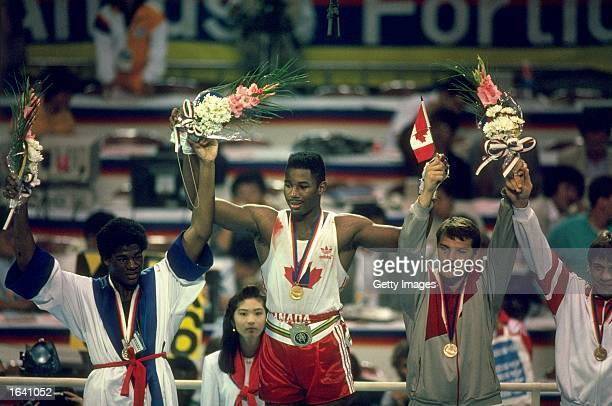 Lennox Lewis of Canada celebrates after receiving the gold medal for the Super Heavyweight bout against Riddick Bowe of the USA during the 1988...