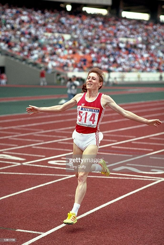 Olga Bondarenko of the USSR celebrates after her victory in the Womens 10,000 metres event during the 1988 Olympic Games at the Olympic Stadium in Seoul, South Korea. Bondarenko won the gold medal. \ Mandatory Credit: Tony Duffy /Allsport