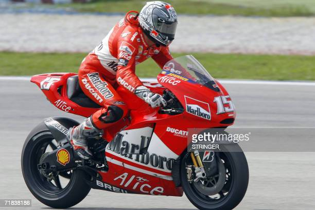 Spanish rider Sete Gibernau of Ducati prepares to take a turn during the Malaysian MotoGP race at the Sepang International Racing Circuit 10...