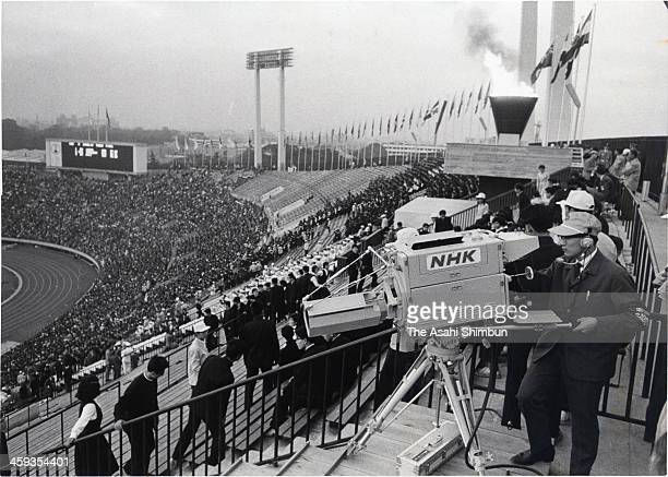 A separate luminance color camera is seen installed at the opening ceremony of the Summer Olympic Games In Tokyo 1964 at the National Stadium in...