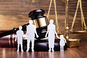 Separation Of Family Figure Cut Out In Front Of Judge Gavel