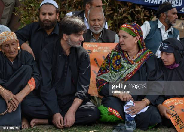 Separatist leader Yasin Malik joins Parveena Ahangar Chairperson of APDP to lead the sit in protest during the International Disappearance day in...