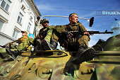 Separatist soldiers sit on a military vehicle during a city celebration in Lugansk on September 14 2014 in Lugansk Ukraine Lugansk a separatist held...