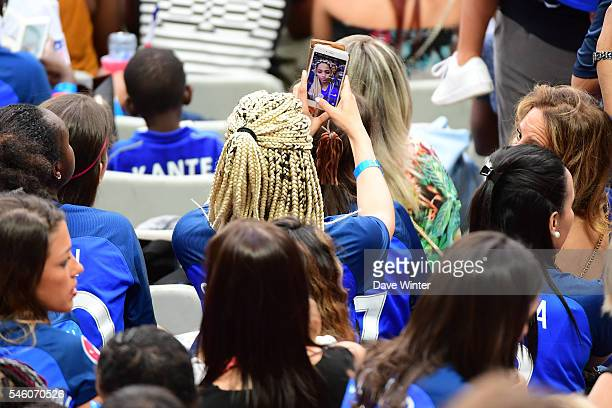 Sephora Coman takes a selfie during the European Championship Final between Portugal and France at Stade de France on July 10 2016 in Paris France