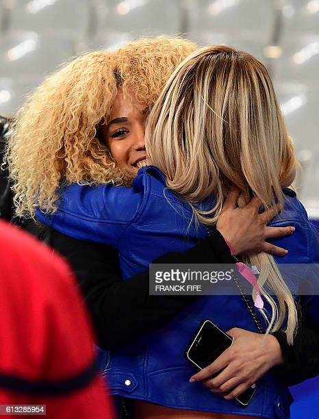 Sephora Coman wife of France's forward Kingsley Coman and Ludivine Payet wife of France's forward Dumitri Payet react after the FIFA World Cup 2018...