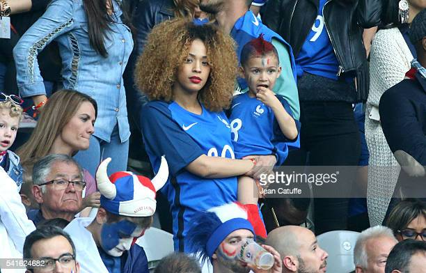Sephora Coman wife of Kingsley Coman and their son attends the UEFA EURO 2016 Group A match between Switzerland and France at Stade PierreMauroy on...