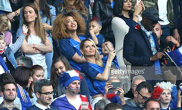 Sephora Coman wife of Kingsley Coman and their son below Ludivine Payet wife of Dimitri Payet and their son attend the UEFA EURO 2016 Group A match...