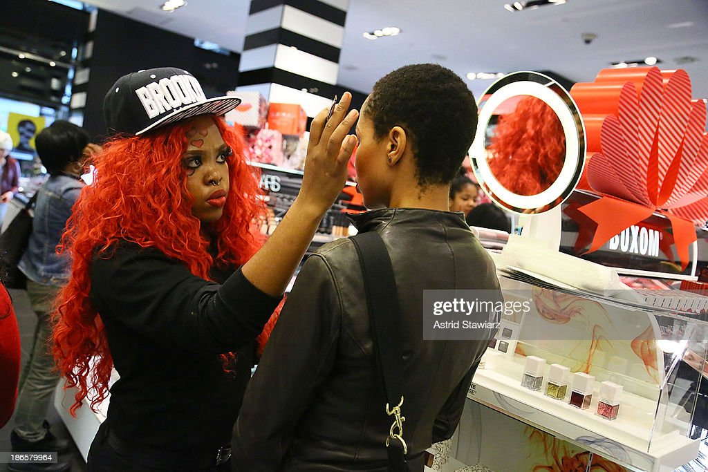 Sephora customers get makeup applied at the Beauty Studio during Sephora Brooklyn Grand Opening on November 1, 2013 in New York City.