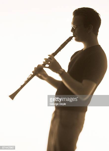 sepia shot of a man playing the clarinet