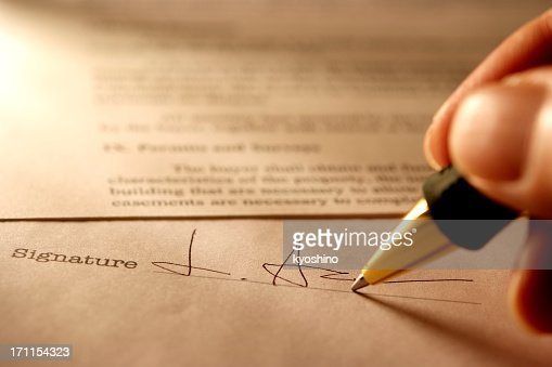 Sepia toned Image of signing a contract with light rays