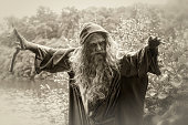 sepia toned image of wizard by lake
