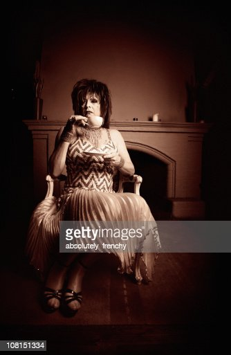 Sepia Toned Portrait of Cross Dressing Male Sipping Tea