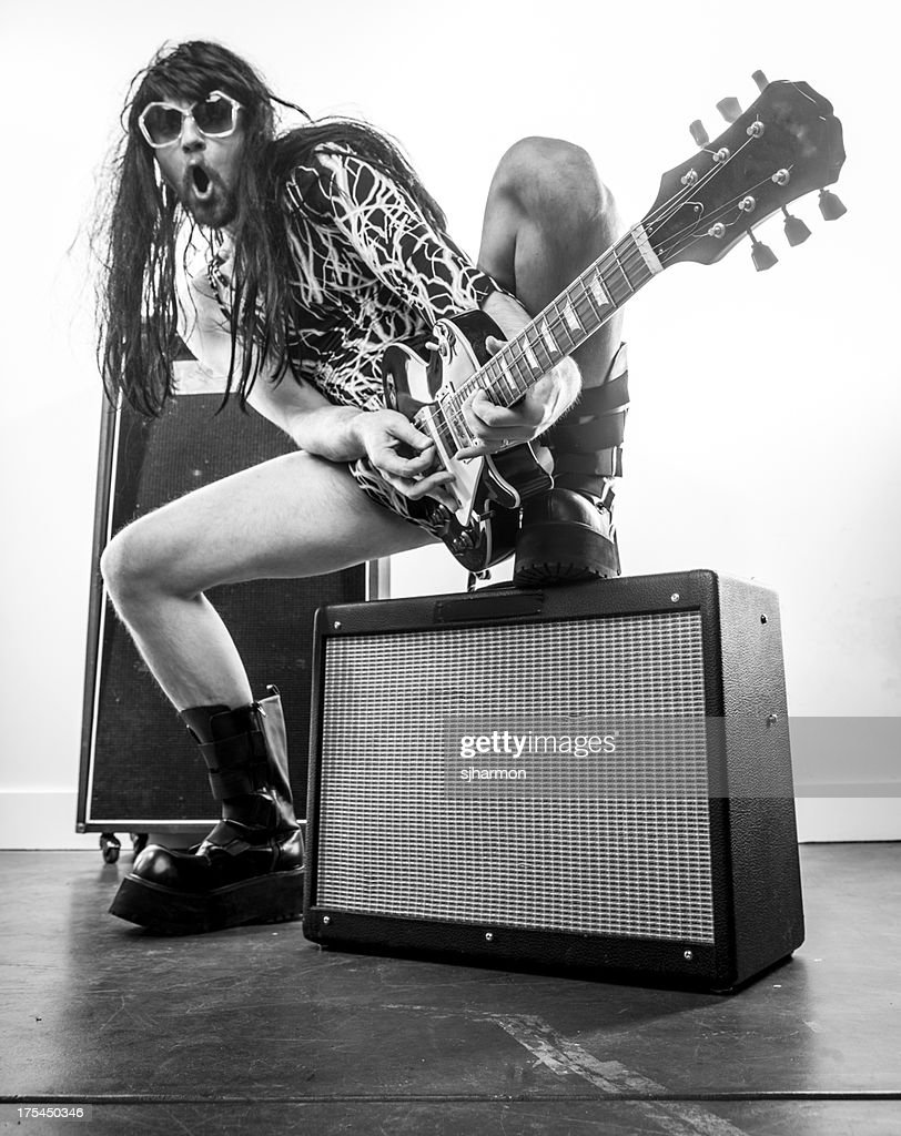 Sepia Wigged Rocker with Sunglasses Electric Guitar and Amps : Stock Photo
