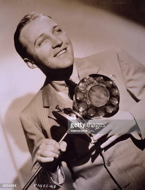 Sepiatoned image American singer and actor Bing Crosby holding an oldfashioned microphone in a promotional portrait for the film 'The Big Broadcast'