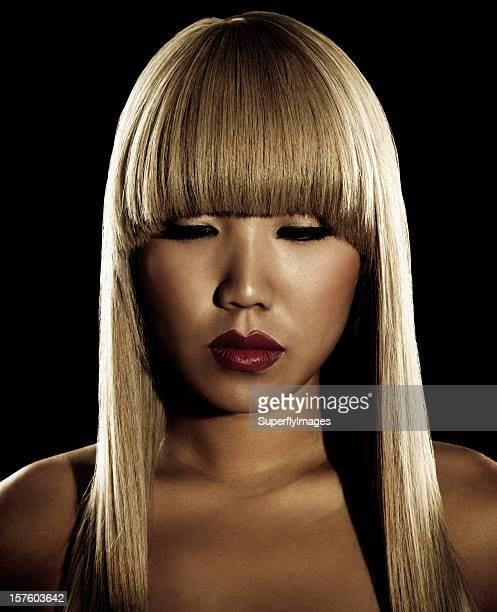 Sepia-toned Portrait of Asian Woman with Long Blonde Hair