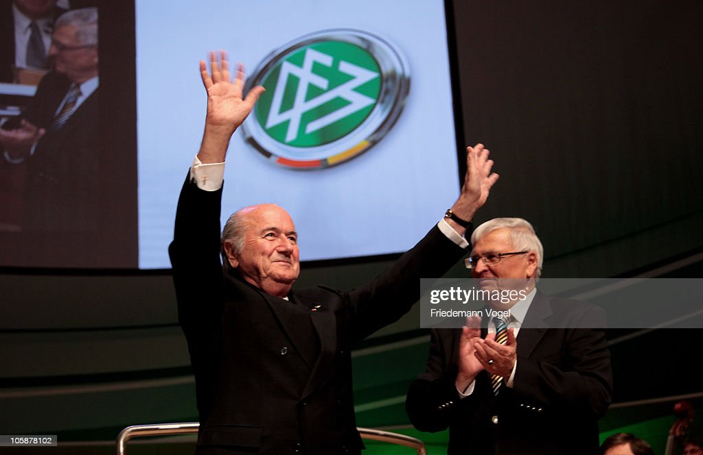 Sepp Blatter, the President of FIFA get the honorary membership of Theo Zwanziger, president of the German Football Association (DFB) during the DFB Bundestag at the Philharmonie on October 21, 2010 in Essen, Germany.