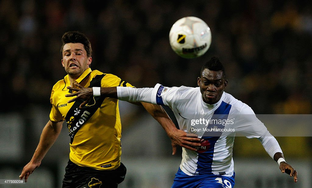 Sepp De Roover (L) of NAC and <a gi-track='captionPersonalityLinkClicked' href=/galleries/search?phrase=Christian+Atsu&family=editorial&specificpeople=8284773 ng-click='$event.stopPropagation()'>Christian Atsu</a> of Vitesse battle for the ball during the Eredivisie match between NAC Breda and Vitesse at the Rat Verlegh Stadion on March 8, 2014 in Breda, Netherlands.