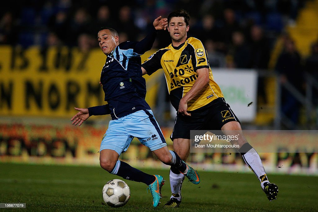Sepp De Roover of NAC and Tjaronn Chery of Den Haag battle for the ball during the Eredivisie match between NAC Breda and ADO Den Haag at the Rat Verlegh Stadium on November 23, 2012 in Breda, Netherlands.