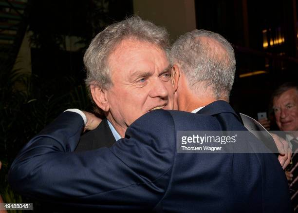 Sepp Maier shake hands with Franz Beckenbauer during the German Football Association wolrd champions party at Intercontinental Hotel on May 31 2014...