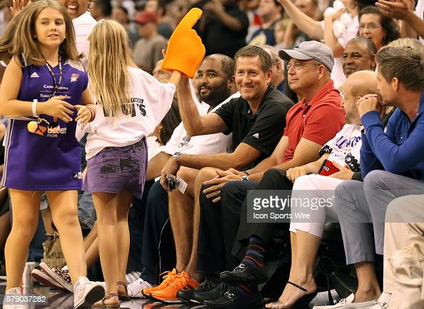 Phoenix Suns Head Coach Jeff Hornacek gives a Mercury fan a hi5 courtside The Phoenix Mercury host the Minnesota Lynx in the 3rd game of the Western...