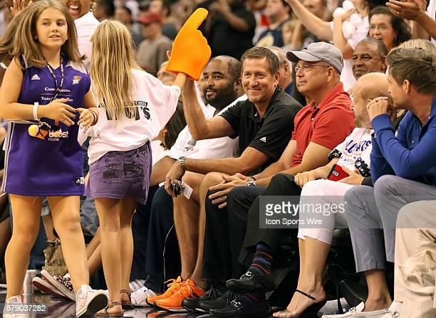 Phoenix Suns Head Coach Jeff Hornacek gives a Mercury fan a hi5 courtside The Phoenix Mercury host the Minnesota Lynx in the 3rd game of the Western...