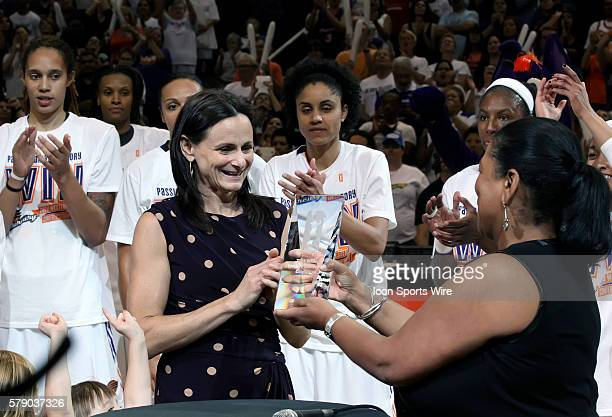 WNBA Commissioner Laurel J Richie presents the Western Conference Champion trophy to Coach Sandy Brondello after the game The Phoenix Mercury host...