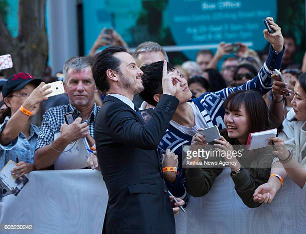 TORONTO Sept 11 2016 Actor Andrew Scott poses for photos with fans before the world premiere of the film 'Denial' at Princess of Wales Theatre during...