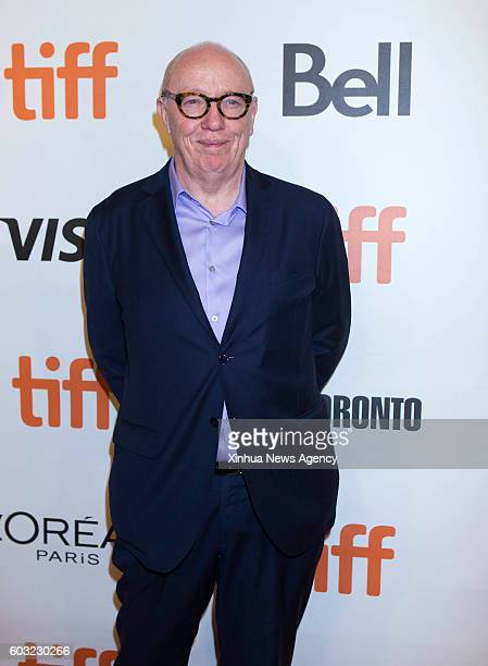 TORONTO Sept 11 2016 Director Terry George poses for photos before the world premiere of the film 'The Promise' at the Roy Thomson Hall during the...