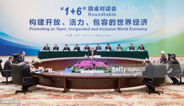BEIJING Sept 12 2017 China's Premier Li Keqiang together with World Bank Group President Jim Yong Kim International Monetary Fund Managing Director...