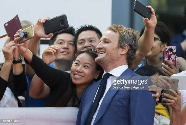 TORONTO Sept 13 2017 Actor Jason Clarke poses for photographs with fans at the international premiere of the film 'Mudbound' at Roy Thomson Hall...