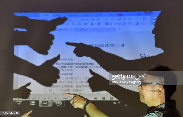BEIJING Sept 13 2017 Hearingimpaird He Xingwu teaches students sign language at a special school in Nanchang capital of east China's Jiangxi Province...