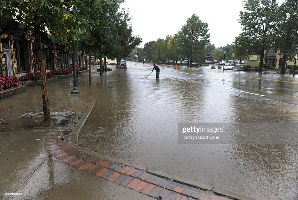 Flood waters are still overflowing on to E Elkhorn Ave As a steady rain continues to fall the town of Estes Park begins to clean up the flooded...