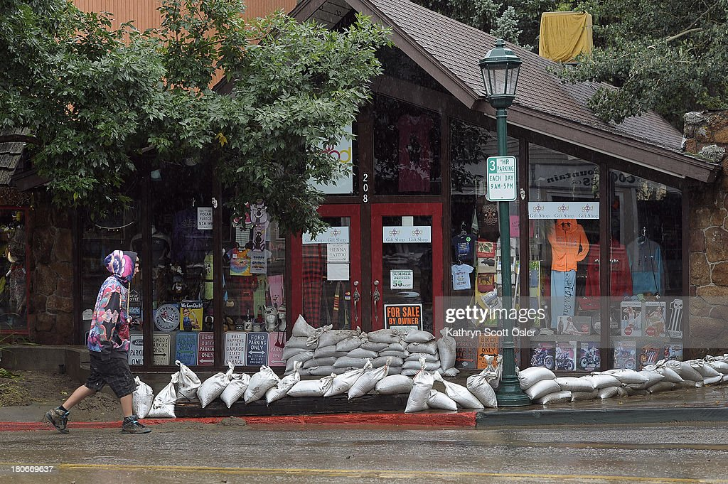 Sandbags are still piled at the front entrance to the Good Karma store on W Elkhorn Ave As a steady rain continues to fall the town of Estes Park...