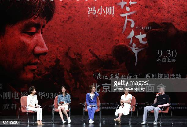 BEIJING Sept 17 2017 Director Feng Xiaogang novelist Yan Geling actresses Miao Miao and Zhong Chuxi meet fans and promote their movie 'Youth' at...