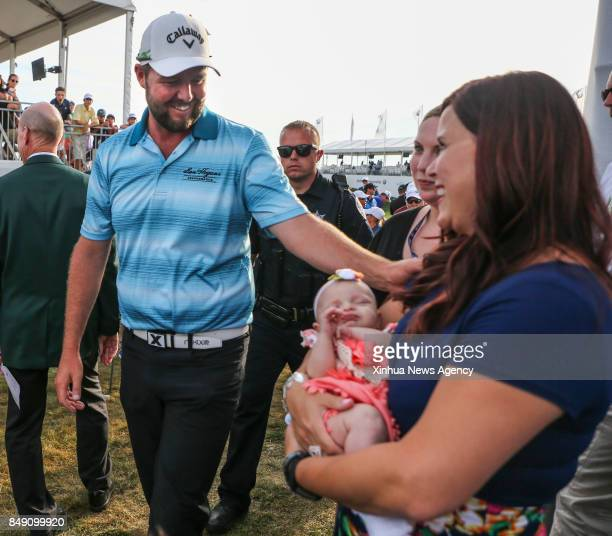 FOREST Sept 17 2017 Marc Leishman of Australia greets his wife and newborn girl during the BMW Championship golf tournament at Conway Farms Golf Club...