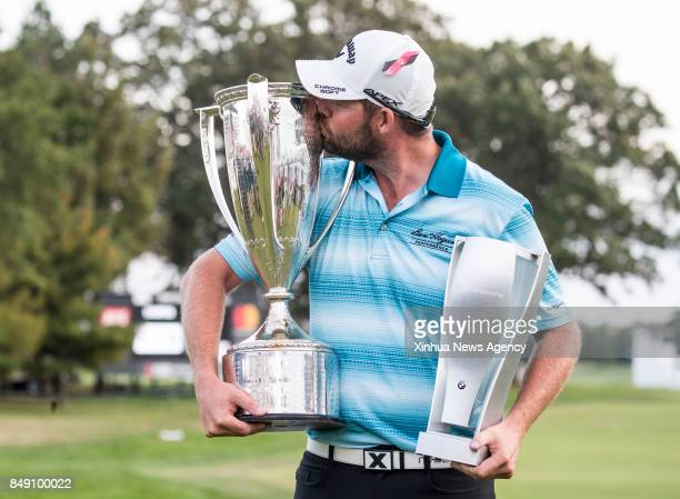 FOREST Sept 17 2017 Marc Leishman of Australia kisses the Wadley Trophy and holds the BMW Championship Trophy after winning the BMW Championship golf...