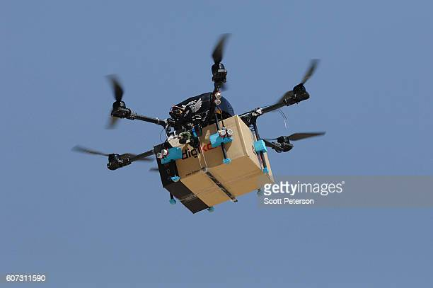 An Iranian drone built by the Amir Kabir University of Technology team takes a flight test to deliver parcels in a competition created by Iran's...