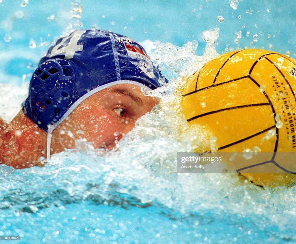 Nikolai Kozlov of Russia pushes the ball up during the match between USA v Russia in the Waterpolo World Cup at the Sydney International Aquatic Centre, Homebush Sydney, Australia. Mandatory Credit: Adam Pretty/ALLSPORT