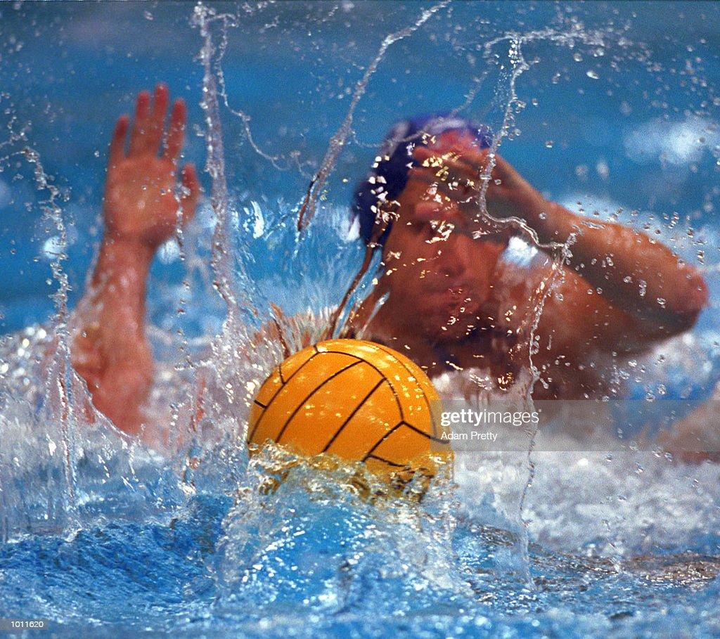 The waterpolo ball sends up a splash, during th USA v Australia preliminary match of the Waterpolo World Cup at the Sydney International Aquatic Centre, Homebush Sydney, Australia. Mandatory Credit: Adam Pretty/ALLSPORT