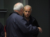 After flying in a helicopter over areas ravaged by the recent flooding Vice President Joe Biden right arrives at the Disaster Recovery Center in...