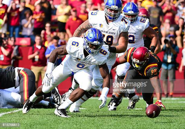 San Jose State Spartans running back Deontae Cooper and Iowa State Cyclones defensive end JaQuan Bailey chase a fumble during a NCAA football game...
