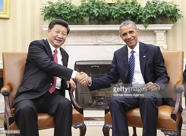 C Sept 25 2015 Chinese President Xi Jinping left shakes hands with US President Barack Obama during their talks in Washington DC the United States...