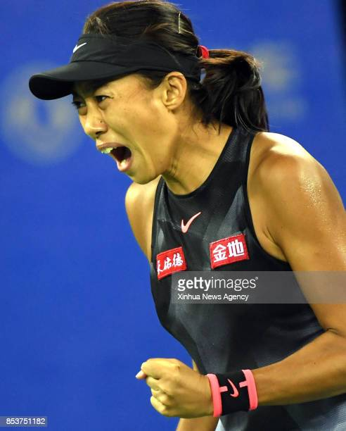 China's Zhang Shuai celebrates during the singles first round match against Donna Vekic of Croatia at 2017 WTA Wuhan Open in Wuhan capital of central...