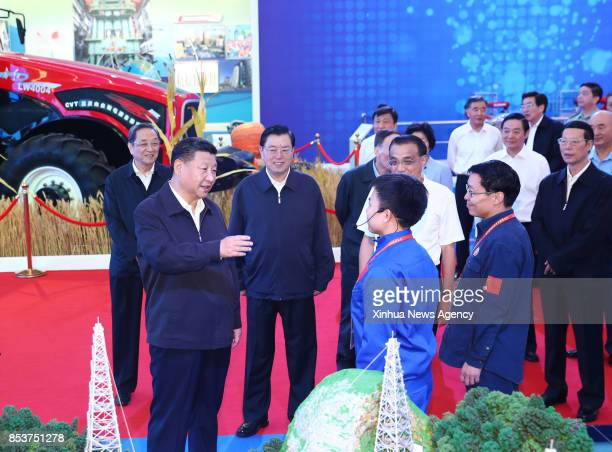 Top Communist Party of China and state leaders Xi Jinping Li Keqiang Zhang Dejiang Yu Zhengsheng Liu Yunshan Wang Qishan and Zhang Gaoli visit an...
