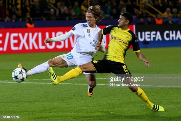 DORTMUND Sept 27 2017 Luka Modric of Real Madrid vies with Mahmoud Dahoud of Dortmund during the UEFA Champions League group H match at Signal Iduna...