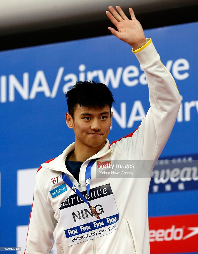 BEIJING, Sept. 29, 2015-- China's Ning Zetao reacts during the awarding ceremony for Men's 50m Butterfly of FINA/airweave Swimming World Cup 2015 at Beijing National Aquatics Center as known as Water Cube in Beijing, capital of China, on Sept. 29, 2015. Ning Zetao took the bronze medal with 24.09 seconds.