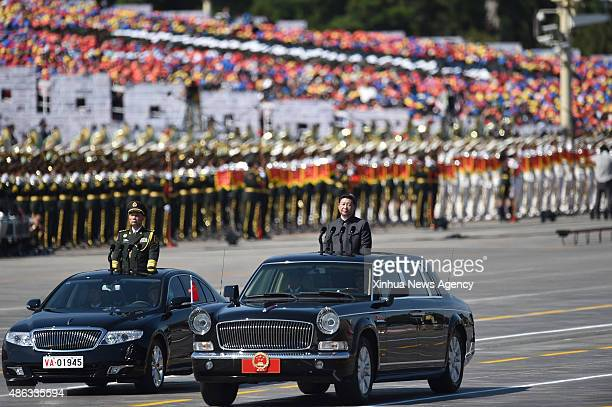 BEIJING Sept 3 2015 Chinese President Xi Jinpin right inspects troops during a parade of the commemoration activities to mark the 70th anniversary of...