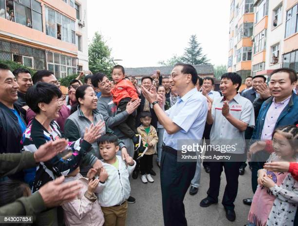 TAIYUAN Sept 5 2017 Chinese Premier Li Keqiang talks with workers and their relatives as he visits the Shigejie Coalmine Residential Community of...